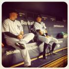 Ichiro Suzuki and Casey McGehee joke around in the dugout during game against the Rays.